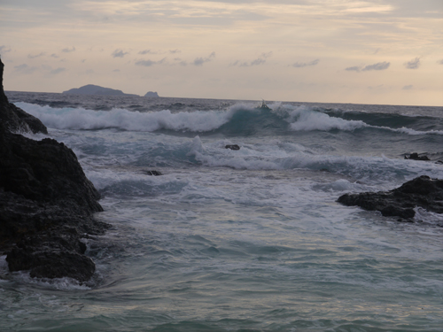 Waves crashing on a remote Fijian Island at dusk