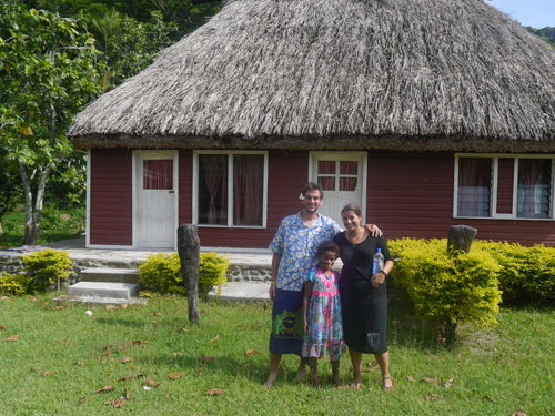 Tourists, fijian girl and Fijian Chief's house