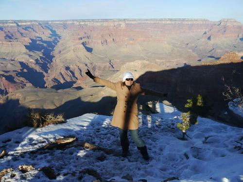 Tam standing on the Grand Canyon, Arizona