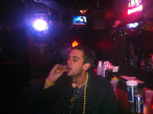 Ben smokes a Cigar