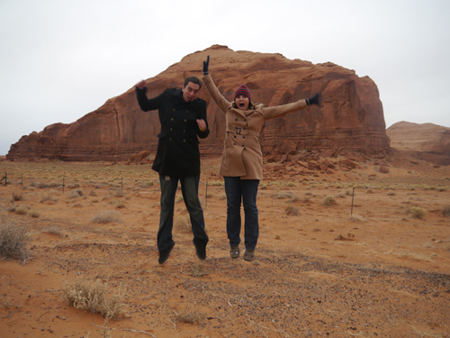 Ben and Tam jumping in Monument Valley