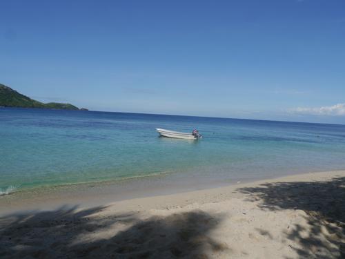 Boat on aqaumarine water in Fiji