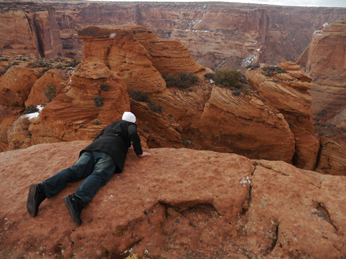 Ben looking over the edge in Canyon de Chelly