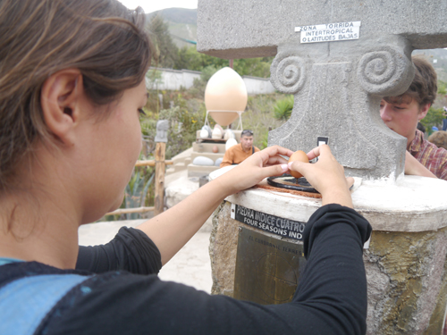 Tam trying to balance an egg on the end of a nail on the equator